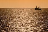 Silhouette Of Fishing Trawler At Dusk
