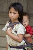 stock photo of hmong  - Hmong people brothers and sisters in Laos living in poverty - JPG