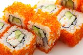 California Maki Sushi with Masago  - Roll made of Crab Meat, Avocado, Cucumber inside. Masago (smelt