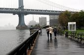 Couple Walking Under Manhattan Bridge Nyc, Rainy Day