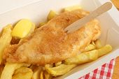 Fish and chips in takeaway carton.