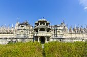 stock photo of jain  - FAMOUS Jain Temple in Ranakpur under blue sky, the holy place for the Jain