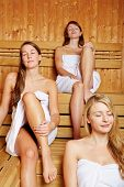 Three attractive women enjoying the sauna together