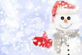 Snowman against snowy field.