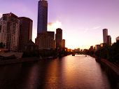 Central Melbourne across the Yarra river on sunset