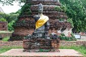 foto of budha  - Ancient buddha partly damage taken outdoor on a sunny day - JPG