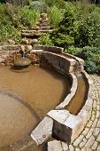 stock photo of chalice  - The Vesica Pool in the Chalice Well Gardens in Glastonbury - JPG