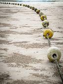 Old Buoys On The Beach