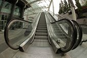 stock photo of escalator  - Moving escalator stairs outside big shopping mall near Victoria station in London - JPG
