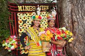 image of ifugao  - Two beautiful Filipina women dress in traditional Ifugao clothing of bright yellow and red woven patterns at Mines View Park in Bagio City Luzon Philippines - JPG