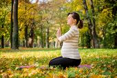 Meditation - pregnant woman outdoor