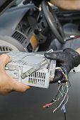Closeup of theft of car radio