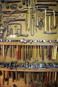 Tools Hanging On Wall Of Workspace