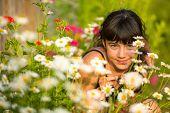Portrait teengirl among wildflowers