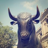 Close up of a Bull Statue in public area with retro effect.