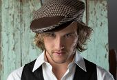 pic of beret  - Handsome caucasian male photographer wearing a vintage formal jacket white shirt and checkered beret - JPG