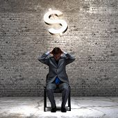 Successful businessman sitting on chair. Money concept