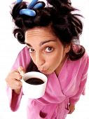 Funny and expressive young woman portrait drinking coffee in the morning.Woman drinking coffee after wake up.