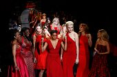 NEW YORK-FEB 6: Celebrities dance on the runway at Go Red for Women-The Heart Truth Red Dress Collec