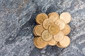 Pile Of Dollar Coins On A Stone Surface