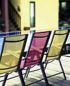 color   deckchairs,  by the pool