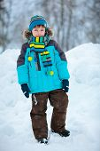 Portrait of cute little boy in winter clothes