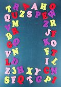 English alphabet on school desk background