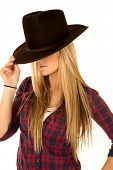 stock photo of coy  - Female model in cowboy hat tipped down - JPG