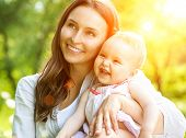 stock photo of mother baby nature  - Beautiful Mother And Baby outdoors - JPG