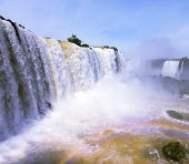 The most high-water waterfall in the world - Iguazu. Boiling water foam, crashing and falling jets,