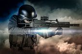 Soldier in uniform with rifle, assault sniper on apocalyptic clouds, firing
