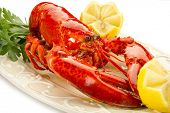 stock photo of lobster tail  - whole lobster on dish - JPG