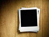 Polaroid empty photo film cards on wood background