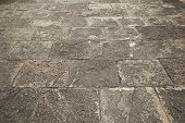 stock photo of cobblestone  - Cobblestoned pavement - JPG