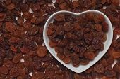 Raisins, dried grape in heart shaped tray
