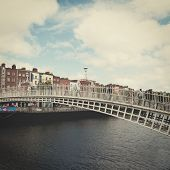The ha'penny bridge in Dublin, Ireland with retro effect.