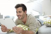 Man websurfing on internet with tablet