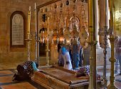 Jerusalem - September 24: Pilgrims pray at the Stone of Unction in the temple of the Holy Sepulchre