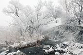 Frozen Stream With Waterfall And Icicles In The Winter, Ukraine
