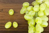 Green Grapes On Oak Shelf