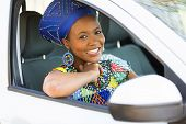 stock photo of traditional attire  - attractive young african woman in traditional clothes inside a car - JPG