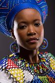 picture of zulu  - beautiful young african zulu lady looking at the camera on black background - JPG
