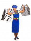 cheerful african zulu woman carrying shopping bags on white background