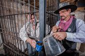 Sheriff Tends To Prisoner