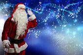 Santa Claus enjoying sound of distant music