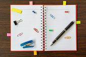 Notebook And Office Equipment On Wooden Table