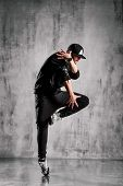 young street style dancer posing on studio background