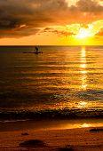 Fisherman Silhouette Fishing At Sunset