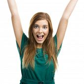 Portrait of a happy beautiful young woman with arms up