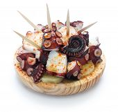 pulpo a la gallega, polbo a feira, spanish tapas cuisine,boiled octopus with paprika, potatoes and olive oil
